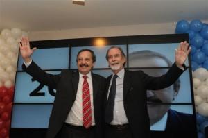 Ricardo Alfonsín junto a González Fraga.