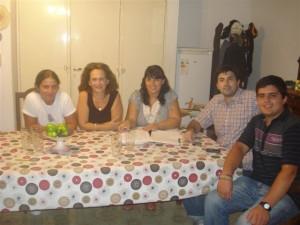 Ana Lia De Salvo, Graciela Blaiota, Lisandro Herrera y Ezequiel Courade, preparan el acto.