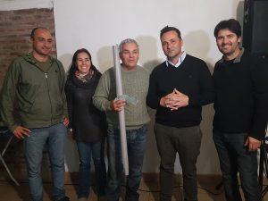 Miguel Ciruli recibe por el Club Sarmiento de Rawson.